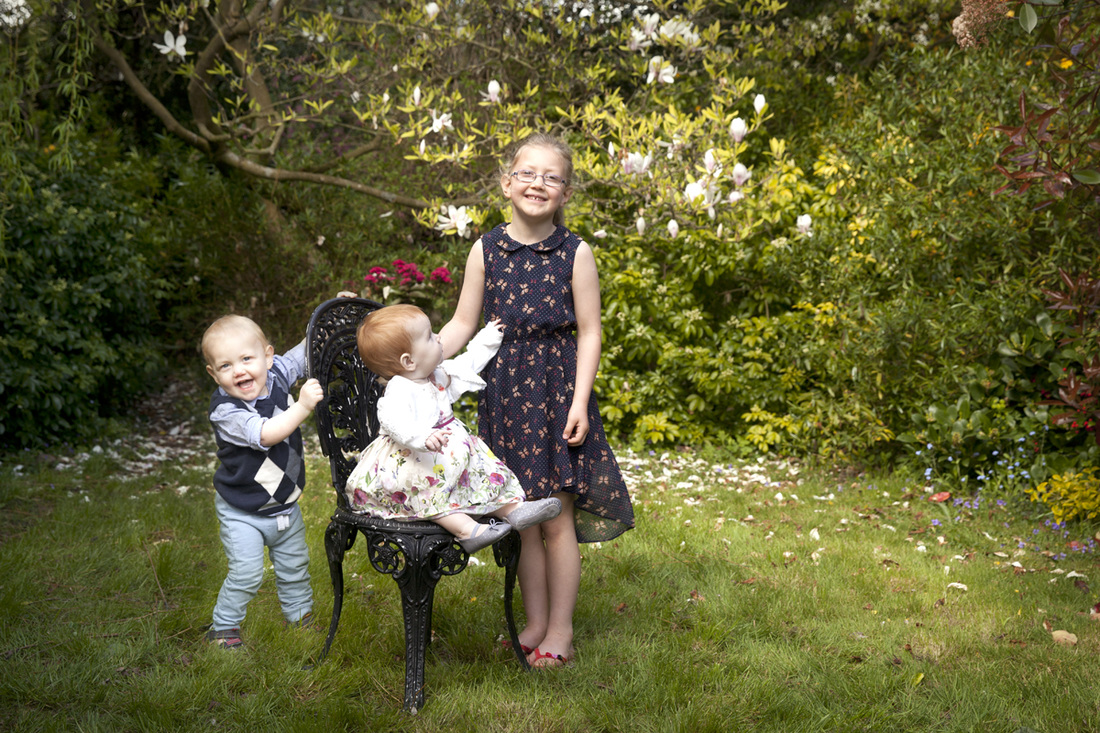 Family photographer London Clare Long Photography cousins magnolia tree