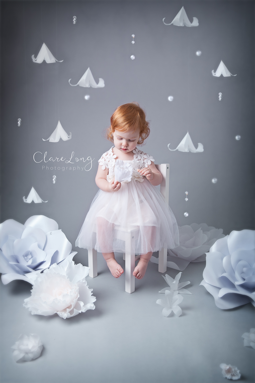 Clare Long Photography Kent photographer handmade set personalised shoot Portrait paper flowers