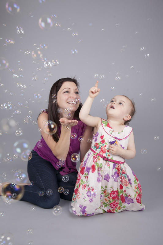 Family photographer London Clare Long Photography Mummy Daughter bubbles