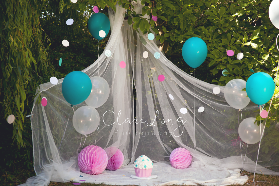 Clare Long Photography Kent photographer handmade set personalised shoot cakesmash outdoors pink and tealPicture