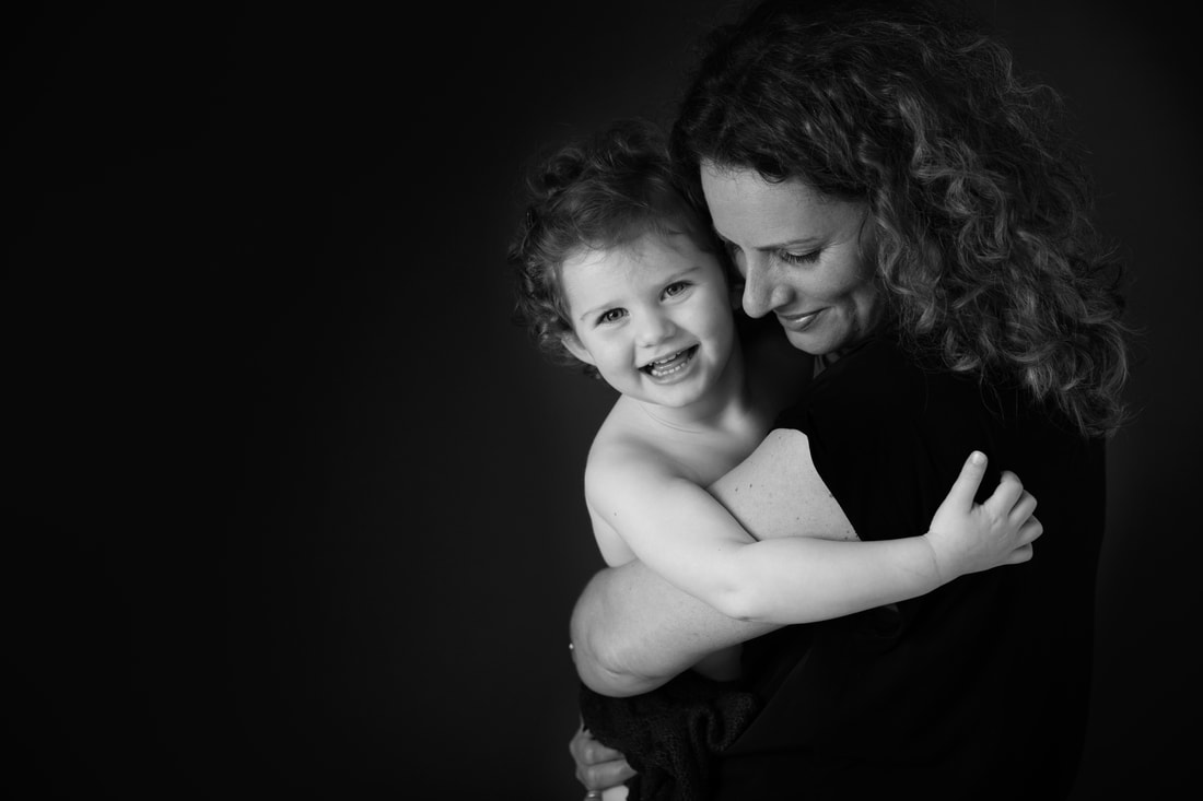 Family photographer London Clare Long Photography proud parents