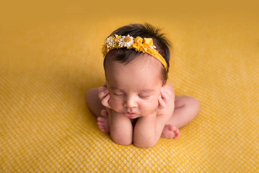Baby girl sleeping in newborn photography pose on mustard composite image for baby safety