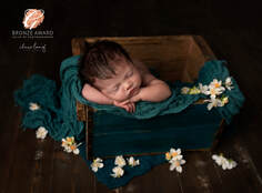 Newborn baby kent sleeping blossoms photoshoot sidcup