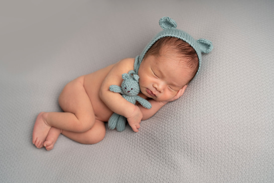 Baby boy sleeping with teddy simple newborn photography in Sidcup