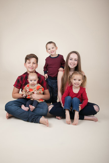 Family photographer London Clare Long Photography smiles cousins